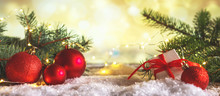 Christmas Decor Composition Of Fir Branches, Cones Red Balls, Candles, On An Abstract Background With Bokeh, Festive Winter Background.Christmas And New Year Concept,banner, Copy Space