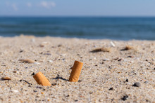 Cigarettes In The Sand Environ...