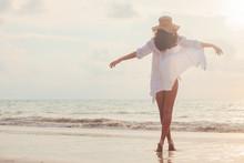 Carefree Woman In Straw Hat Wa...