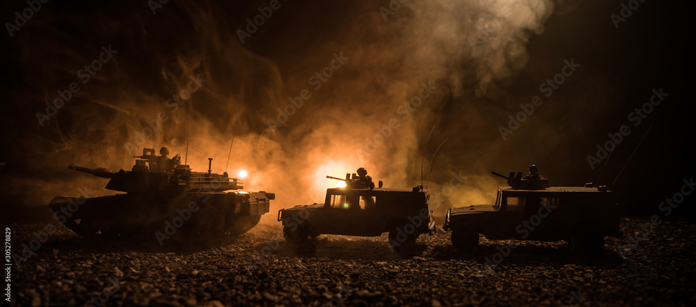 Fototapeta Military patrol car on sunset background. Army war concept. Silhouette of armored vehicle with soldiers ready to attack. Artwork decoration. Selective focus