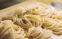 Pasta Fresh (italian Spaghetti) In Classic Style On White Background. Homemade Cooking