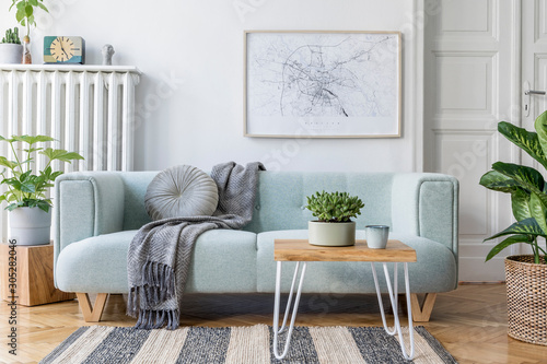 Fototapeta Stylish scandinavian living room interior with design mint sofa, furnitures, mock up poster map, plants, and elegant personal accessories. Home decor. Interior design. Template. Ready to use.  obraz na płótnie