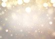 Christmas glowing Golden Background. Christmas lights. Gold Holiday New year Abstract Glitter Defocused Background With Blinking Stars and sparks. Blurred Xmas Bokeh. Greeting card art design