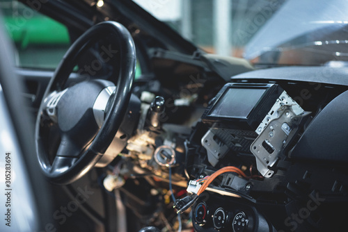 Photo Disassembled car interior close up in car auto service.