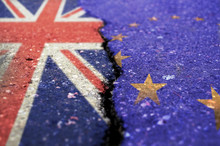 UK And EU Flag On Asphalt Divi...