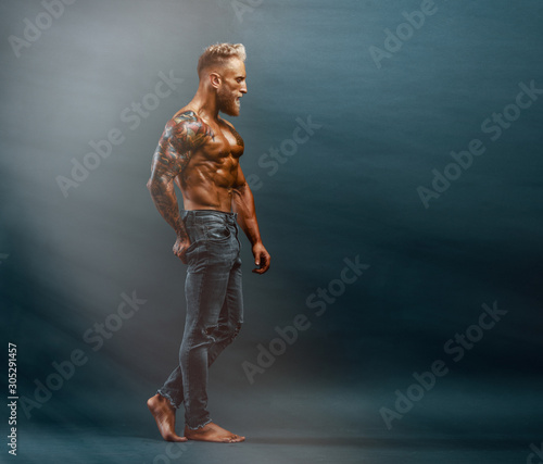Handsome Muscular Shirtless Men In Jeans Posing Wall mural