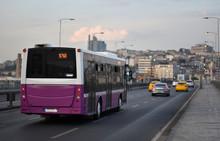 Evening CItyscape Scene With Public Route Bus Which Pass Across Ataturk Bridge In City Traffic