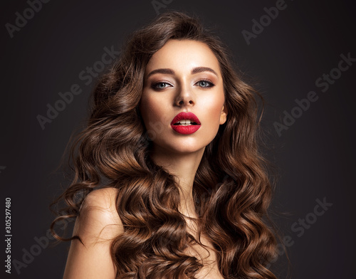 Obraz na plátně Beautiful face of young woman with red lipstick