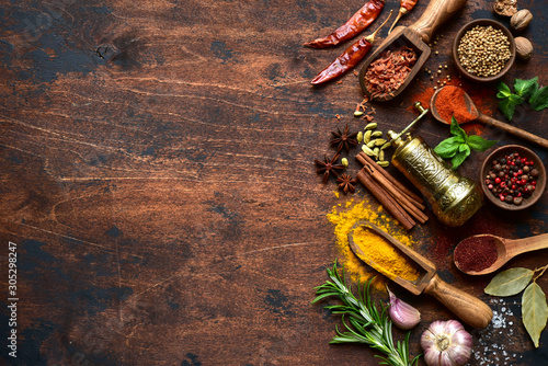 Assortment of spices and herbs. Top view with copy space. Obraz na płótnie