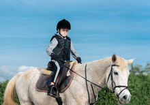 Boy Horseback Riding At Ranch