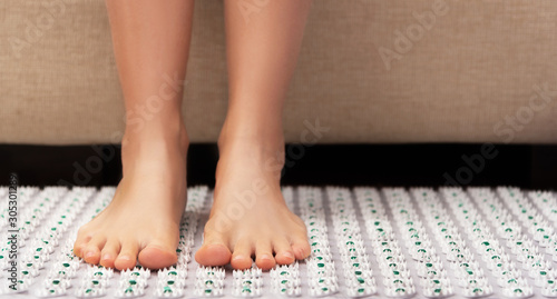 Female feet on acupressure mat Canvas Print