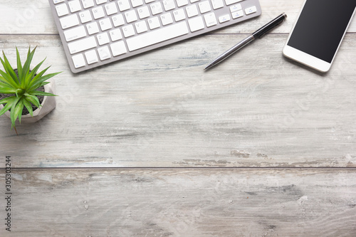 Obraz White desk office with laptop, smartphone and other work supplies with cup of coffee. Top view with copy space for input the text. Designer workspace on desk table essential elements on flat lay - fototapety do salonu