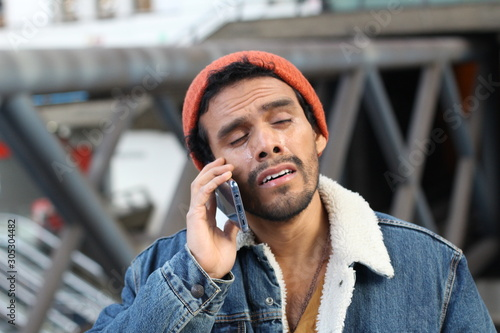 Capricious man crying on the phone Canvas Print