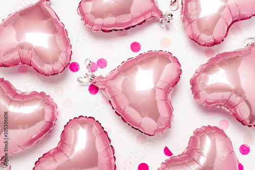 Photo  Pink air balloons heart shape on a white background