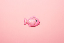 Plastic Toy Fish On A Pink Bac...