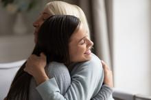 Close Up Image Grown Up Daughter Hugging Elderly Mother