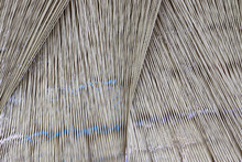 Close Up Of A Lot Of Threads In A Weaving Machine Called A Loom