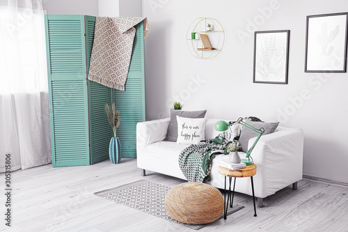 Fotografía  Stylish interior of living room with comfortable sofa