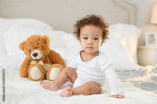 Obraz Cute baby with fluffy hair. Pretty boy. - fototapety do salonu