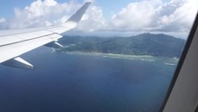 Aerial View Out Of An Etihad Airways Airbus A330-300s Right Window On Final Approach To Mahe Island, Seychelles On A Sunny Day With Few Clouds In The Sky.