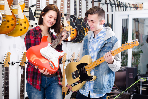 Female and male are deciding on suitable amp Canvas Print