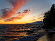 canvas print picture - Waves crashing on rocks during a colorful sunset