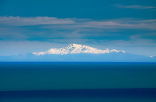 Snow Caped Mountain Peaks In T...