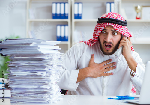 Arab businessman working in the office doing paperwork with a pi Canvas Print