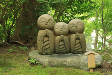 Small Statues Of Baby Buddhas Surrounded By Fresh Green At The Hase-Dera Temple In Kamakura, Japan
