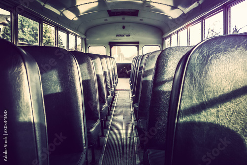 Dark shadowy empty interior of an old school bus Wallpaper Mural