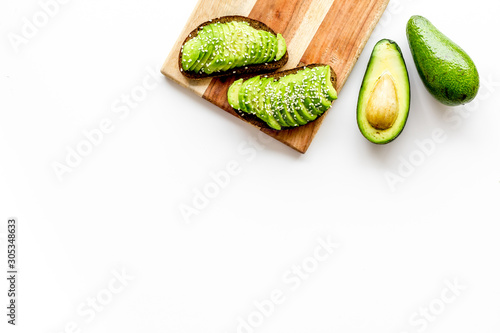 Healthy food. Avocado toast on white background top view frame copy space
