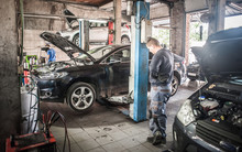 Car Mechanic Working In A Repa...
