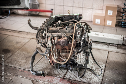 Car engine repair in service workshop, removed engine from car Fototapet