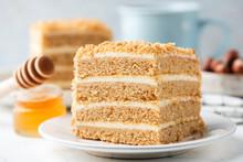 Russian Honey Layer Cake Medovik Slice. Closeup View. Biscuit Honey Layers With Pastry Cream. Tasty Dessert Square Cake