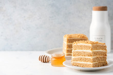 Medovik Honey Layer Cake On White Plate Over Grey Concrete Wall Background. Cake Slice With Copy Space