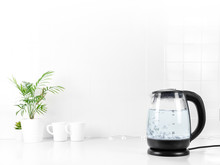 Glass Transparent Kettle On White Kitchen Table