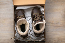New Brown Leather Insulated Winter Boots With Membrane And Fur. In Box Top View. Flat Lay