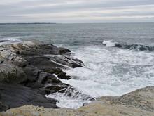 Foaming Waves Rolling Toward Rocky Shores