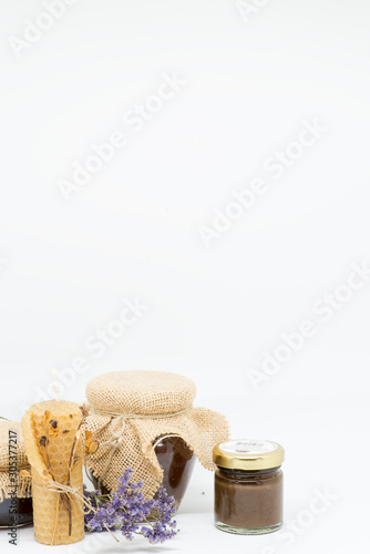 Photo jar of honey bees and beeswax candle with dried flowers