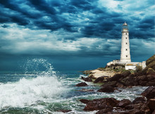 Lighthouse Sits On The Edge Of...