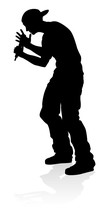 A Singer Pop, Country Music, Rock Star Or Hiphop Rapper Artist Vocalist Singing In Silhouette