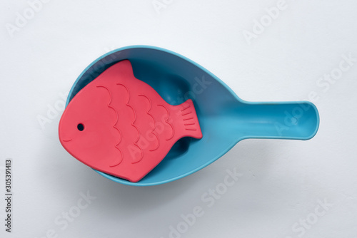 children's toys on suction cups in the bucket games in the tub for kids on a white background