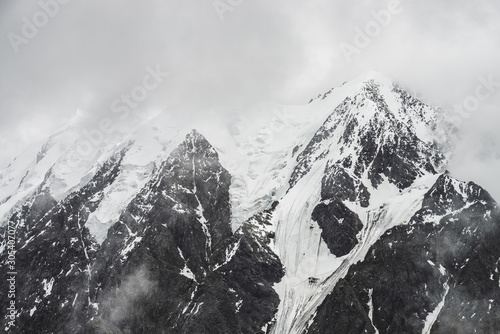 Fotografia, Obraz  Atmospheric minimalist alpine landscape with massive hanging glacier on snowy mountain peak