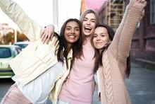 Outdoor Shot Of Three Young Women Having Fun On City Street