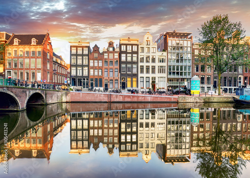 Vászonkép Amsterdam Canal houses at sunset reflections, Netherlands