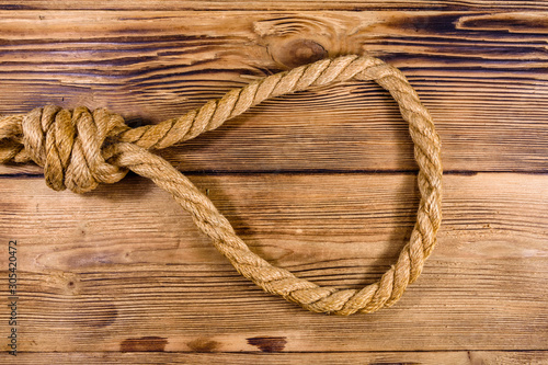 Fototapeta  Rope with noose for the suicide on wooden background