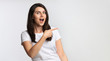 Excited Young Woman Pointing Finger Aside Standing In Studio, Panorama