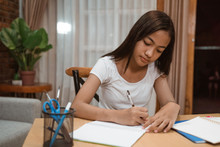 Portrait Of Young Teenager Junior High School Student Studying At Home