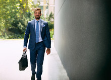 Smiling Businessman Going To Work
