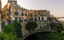 The Arethusa's Fountain In The Historic City Center On The Island Of Ortygia In Syracuse At Sunrise, Sicily, Italy
